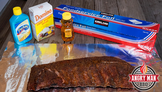 Competition style ribs have brown sugar, honey and liquid margarine added