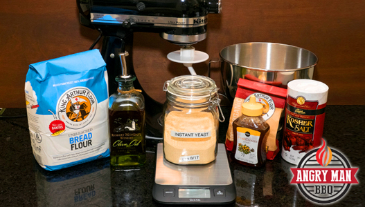 Ingredients gathered to make a whole wheat pizza dough.