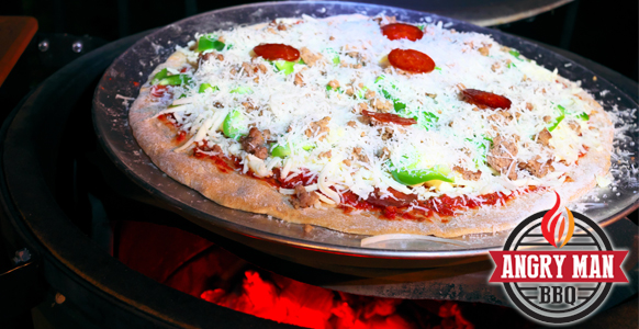 Allow the crust to begin baking by placing the holy pan directly on the hot pizza stone.