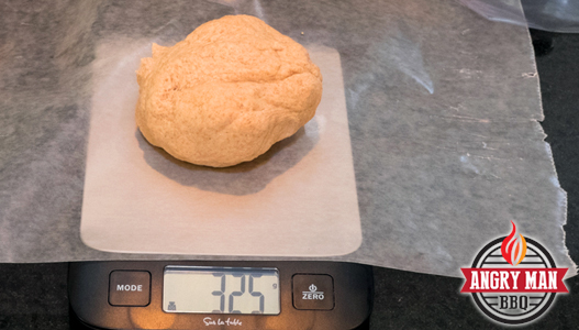 This recipe shuld yield 4 dough balls at 325 grams each. The dough should rest and be at room temperature before you try to press it out into a pie.