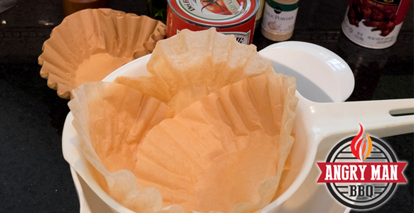 Line a colander with coffee filters to drain excess liquid from the crushed tomatoes