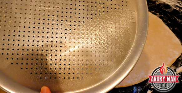 Use a pan with lots of holes in it. Be careful when spraying it with cooking oil.