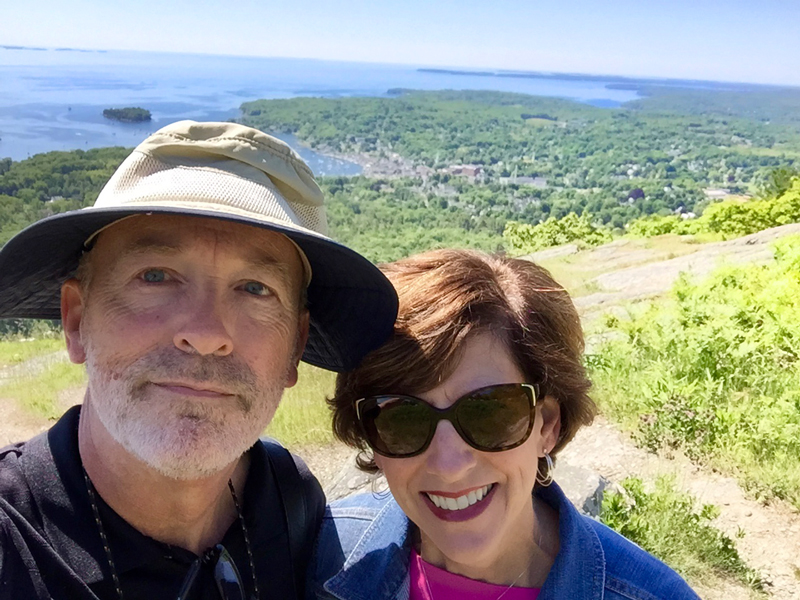 A happy couple of travelers atop Mt Battie. That's Camden in the background.